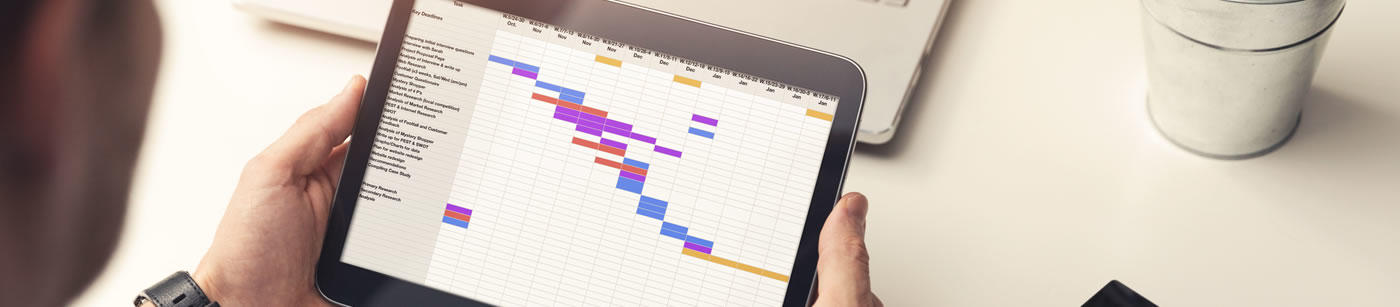 project-manager-looking-at-gantt-chart-on-digital-tablet-in-office